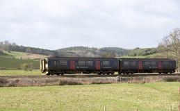 Passenger train travels south of Exeter in Devon UK Stock Photos