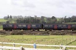 Passenger train travels south of Exeter in Devon UK Stock Image