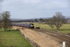 Passenger train travels south of Exeter in Devon UK Royalty Free Stock Image