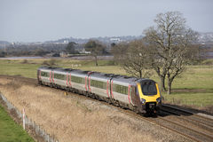 Passenger train travels south of Exeter in Devon UK Royalty Free Stock Photo