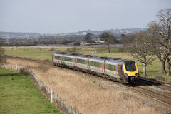 Passenger train travels south of Exeter in Devon UK Stock Photography