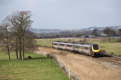 Passenger train travels south of Exeter in Devon UK Stock Photo