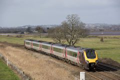 Passenger train travels south of Exeter in Devon UK Royalty Free Stock Photography