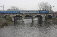 The Passenger train on viaduct Royalty Free Stock Image