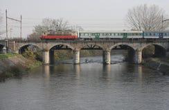 The Passenger train on viaduct Stock Photos