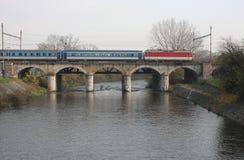 The Passenger train on viaduct Stock Photo