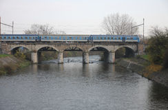 The Passenger train on viaduct Stock Images