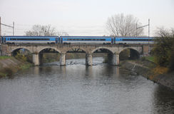 The Passenger train on viaduct Royalty Free Stock Images