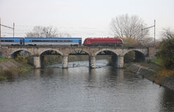 The Passenger train on viaduct Royalty Free Stock Photo