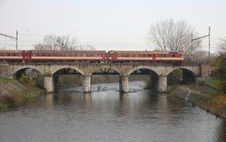 The Passenger train on viaduct Stock Image