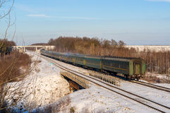 Passenger train during wintertime in Ukraine Royalty Free Stock Photography