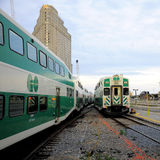 Passenger trains. First passenger train (on the left) arrives, second passenger train (on the right) departs from Toronto Union station on June 27, 2011 in Stock Photos