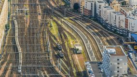 Passenger trains moving back and forth on railroad tracks, top view, timelapse. Stock footage stock video