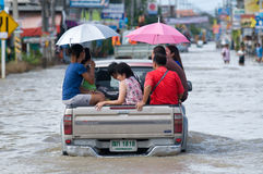 Passenger transport in flooded Thailand. NAKHON RATCHASIMA - OCTOBER 24: Pickup truck transporting flood victims through the streets of the city during the worst Stock Image