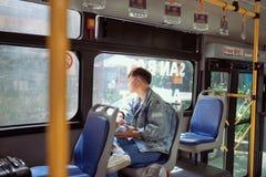 Passenger traveler looking at window in bus, man tourist sitting. In bus Royalty Free Stock Photos