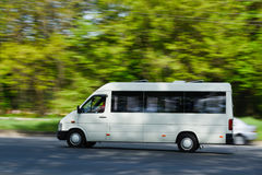 A passenger van in motion