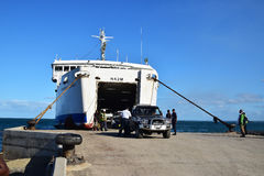 Passenger vehicles coming out from a large ferry at Natovi Landing nearby Suva, Fiji Stock Images