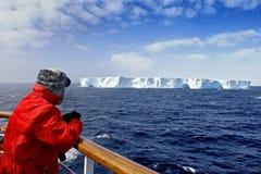 Passenger viewing Iceberg. Passenger looking at huge iceberg at Antarctica Royalty Free Stock Image