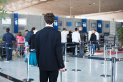 Passenger waiting  in the airport. People at the airport, passenger waiting in queue to check in and drop off luggage Royalty Free Stock Photo