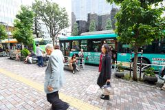 Japan: Waiting for public bus. Passenger waiting for bused at a busstop in 1 of the many city in Japan Stock Image
