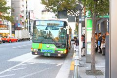 Japan: Waiting for public bus. Passenger waiting for bused  at a busstop in 1 of the many city in Japan Stock Photo