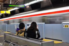 Passenger waiting for fast train. The picture illustrates the passengers waiting for fast train at one of the Tsukuba Express train station in Kenkyu-Gakuen Royalty Free Stock Image