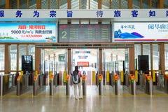 Passenger waiting front of station gates Stock Photography