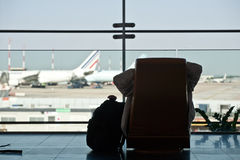 Passenger waiting for his flight Royalty Free Stock Images
