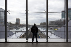Passenger waits in central hall of utrecht railway station in ho Royalty Free Stock Images
