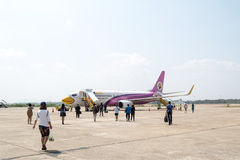 Passenger walking to airplane   of  Nok Air Airline Stock Photography