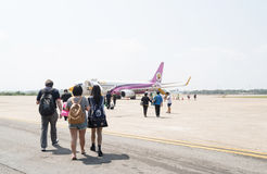 Passenger walking to airplane   of  Nok Air Airline Stock Images
