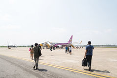 Passenger walking to airplane   of  Nok Air Airline Royalty Free Stock Photos