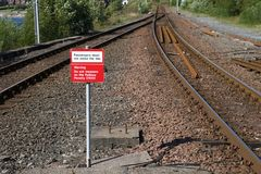 Passenger warning sign at railway train station stating do not trespass or penalty fine will be issued if you cross the rail line. Uk stock images
