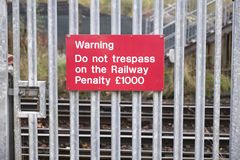 Passenger warning sign at railway train station stating do not trespass or penalty fine will be issued if you cross the rail line. Uk stock photos