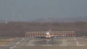 Passenger white plane landing on the runway strip at the airport on a sunny day stock video footage