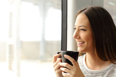 Passenger woman drinking coffee during a train travel Stock Images