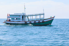 Passenger wooden boat in tourist business in thailand floating o Stock Photos
