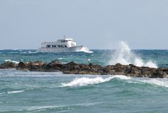 Passenger yacht speeds along the ocean. Stock Photo