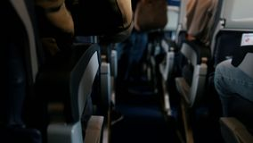 Passengers aboard the aircraft fasten their seat belts stock video