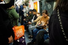 Passengers aboard a crowded subway carriage of the Shanghai Metro royalty free stock photo