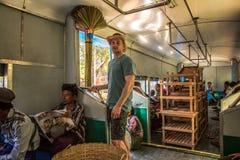 Passengers aboard the local circle train in Yangon, Myanmar Royalty Free Stock Photo