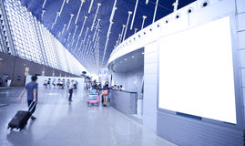 Passengers and ad board with copy space in Shanghai Pudong Inter. LCD TV with empty copy space at  Shanghai pudong airport shot in asia, china Royalty Free Stock Images