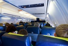 Passengers in aircraft Stock Image