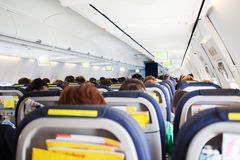Passengers on airliner. Rear view of passengers seated on airliner Stock Photography