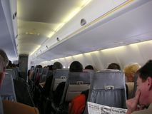 Passengers in Airplane cabin Stock Photo