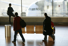 Passengers at the airport. Passengers walking in the airport Royalty Free Stock Images