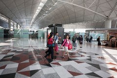 Passengers at the airport in Hong Kong Stock Image