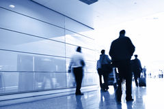 Passengers in the airport interior Stock Image