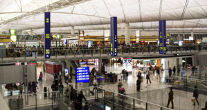 Passengers in the airport main lobby in Hong Kong Royalty Free Stock Photo