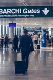 Passengers at the airport. motion blur. Checking baggage. A man with a suitcase. Passengers at the airport. motion blur. Checking baggage. A man with a suitcase Royalty Free Stock Photo